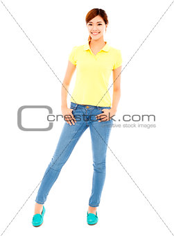 young woman standing and hands on pocket