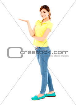 young girl raise her hand to show  something out