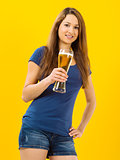 Smiling young woman drinking beer