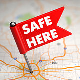 Safe Here - Small Flag on a Map Background with.