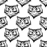 Seamless pattern of the head of a fierce owl