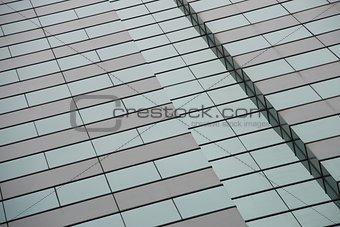 Angled green and grey windows of skyscraper