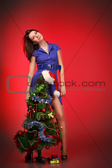beautiful girl near christmas tree