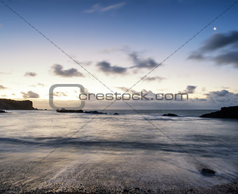 Beach sunrise landscape with long exposure waves movement