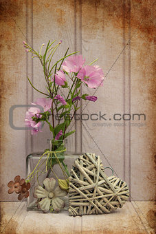 Beautiful flower in vase with heart still life love concept