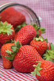 Tasty fresh strawberries in glass storage jar