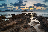 Stunning landscapedawn sunrise with rocky coastline and long exp