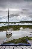Landscape of moody evening sky over low tide marine Creative con
