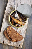 Sprats in a tin and fork.