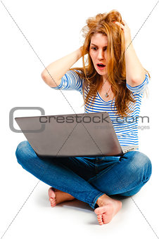 girl with laptop expresses emotions