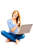 beautiful smiling woman sitting with a laptop