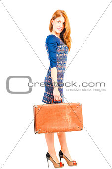 beautiful girl in a dress with an old suitcase