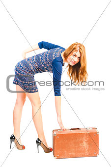 young woman in the studio and an old suitcase