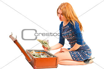 beautiful girl with retro suitcase full of money