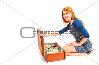 smiling girl and a suitcase full of money