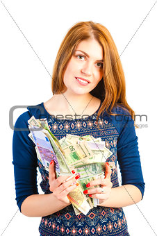 A young woman holds a bunch of money
