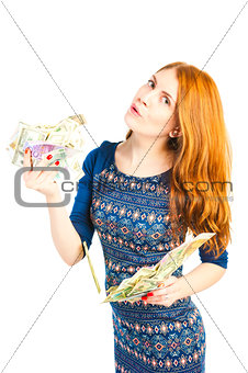 beautiful young woman holding money in both hands