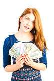 portrait of a beautiful woman with money in studio