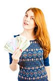 girl with a fan made ​​of money isolated on white background