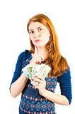 Pensive beautiful girl with money