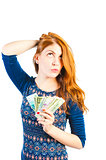 beautiful woman posing on a white background with money