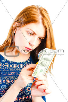 bank employee checks on the authenticity of money