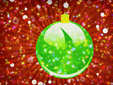 Green Christmas ball on sparkle background