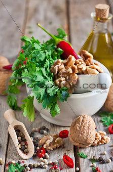 Cilantro and walnuts in a mortar