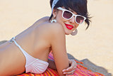 a beautiful young girl in retro look with red lips in a white swim suit