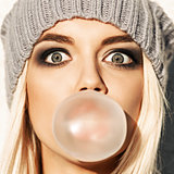 Beautiful blonde girl in beanie hat with smokey eye make up who