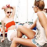 two beautiful girls at sea pier