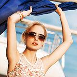 beautiful girl in summer dress at sea pier