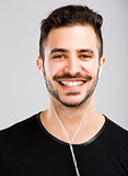 Man smiling and listen music