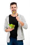 Young man eating a salad