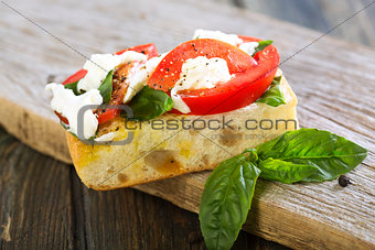 Tomatoes, mozzarella and basil on ciabatta.