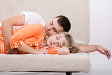 Young couple sleeping on the couch