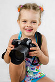 merry girl keeps SLR camera