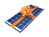 Solar battery decorated with an orange ribbon.