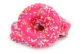 donuts coated with a pink frosting and sprinkles of different co