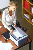 a businesswoman using copier machine