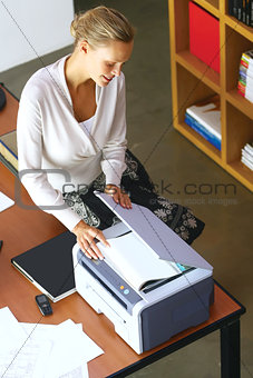 a businesswoman using copier machine