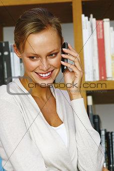 woman using black mobile phone