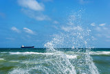 Ð¡argo ship and splashing waves