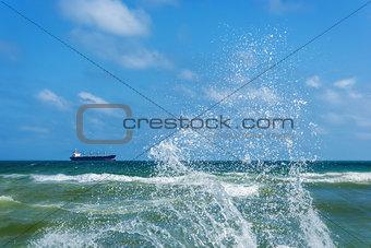 Ð¡argo ship and splashing waves