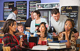 Man Annoying Students in Cafe
