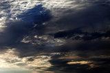 Dark sky with sunlight clouds in evening