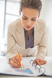 Business woman writing in document