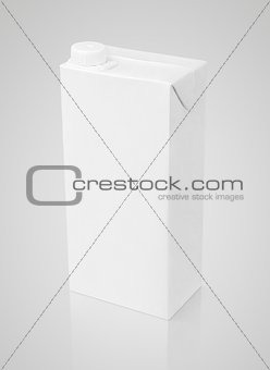 Blank white carton package of juice on gray