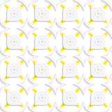 White and yellow geometrical perforated leaves and rhombuses sea