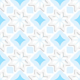White snowflakes on flat blue ornament seamless